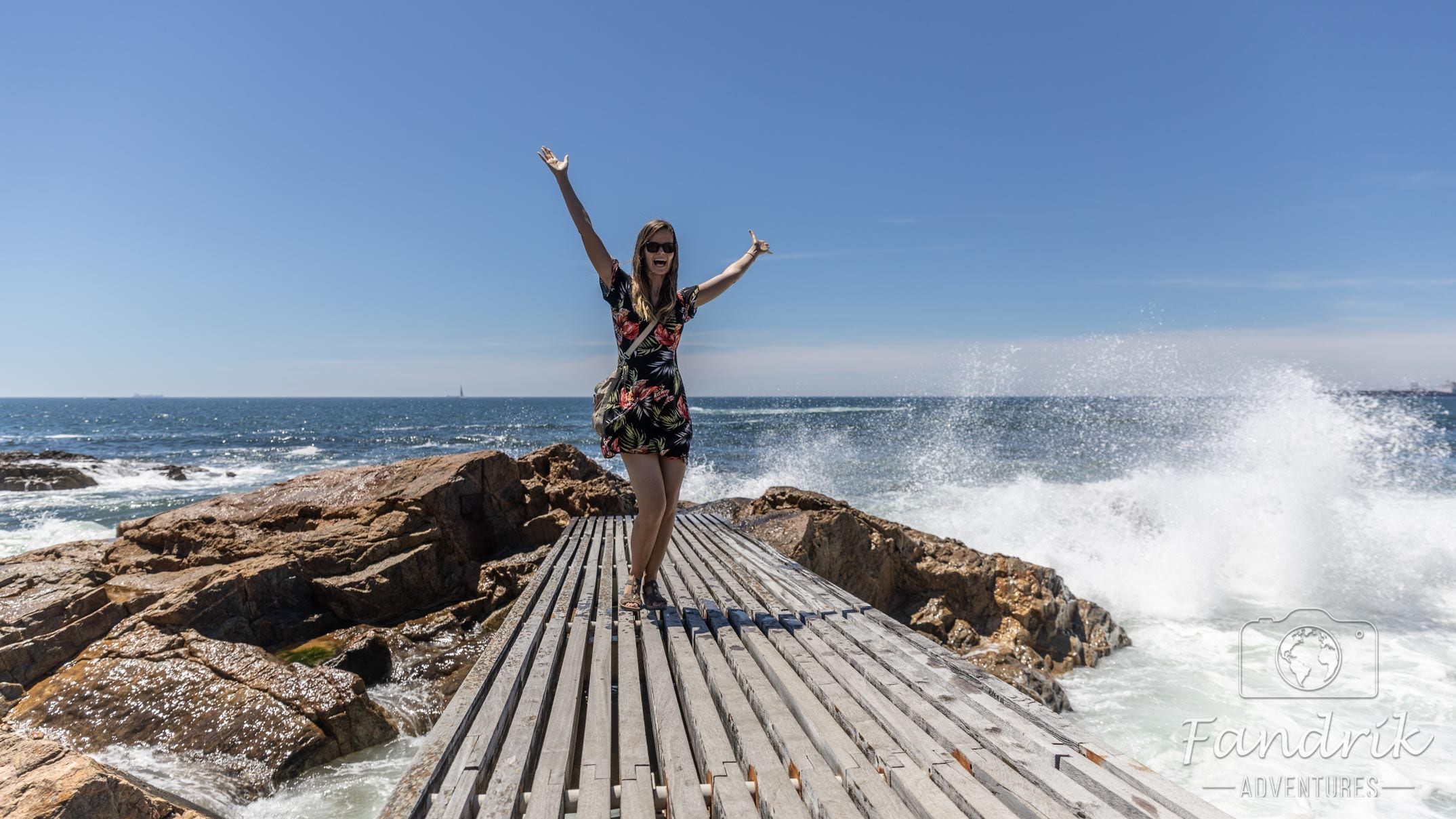 A woman poses on a wooden walkway on the Atlantic coast off Portugal.